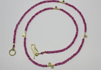 Wonderful bright pink faceted sapphire beads with 18ct yellow gold clasp and features.