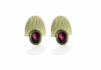Rubellite tourmalines set in textured 18ct gold. Stud fittings.