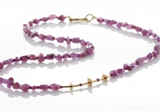 Ruby corundum rough cut stones with tiny faceted ruby beads and 18ct gold features and clasp.