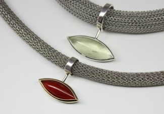 Necklaces - From a selection of cabochon stones on steel bands.