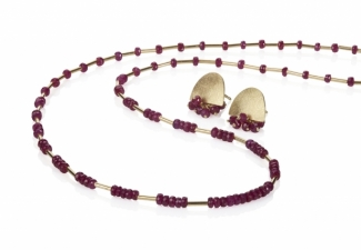 Rich, deep coloured, \'A\' grade ruby faceted beads and 18ct gold. Co-ordinating earrings sold separately.