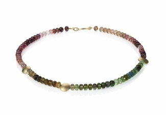 Faceted tourmalines displaying their full colour spectrum, with handmade 18ct gold textured feature beads and clasp.