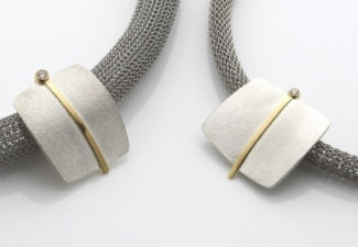 Necklaces - Silver, 18ct yellow gold and diamond pendants on steel bands