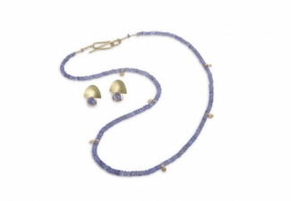 Pale tanzanite faceted beads with 18ct gold features and clasp. Co-ordinating 18ct matt and textured earrings with tanzanite cabochons are sold separately.