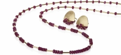 Rich, deep coloured, 'A' grade ruby faceted beads and 18ct gold. Co-ordinating earrings sold separately.