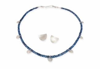 Faceted and graduated kyanite  rondelles with textured silver features and coordinating earrings in signature shape.