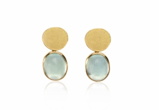 Oval aquamarine cabochons set in 18ct gold with organically shaped textured studs studs.