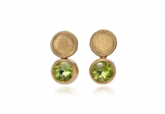 Pale, liquid green faceted buff top peridots hang from organic shaped textured studs
