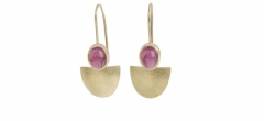 Pink tourmalines set in 18ct gold on wires.