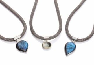Silver pendants set with labradorites and a green moonstone set in 9ct gold. All on stainless steel necklaces.