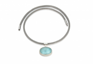 An oval aquamarine set in polished silver on a steel necklaceSueLewis