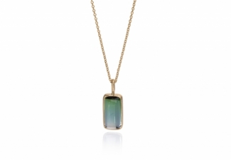 A clear blue/green cushion shaped cabochon tourmaline set in 18ct gold with 18ct chain and clasp.