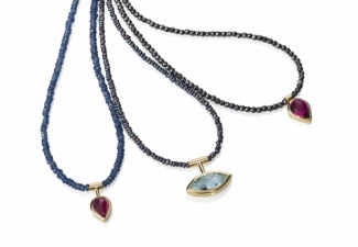 Necklaces - Fine beaded sapphire, seed pearl and hematite necklaces set with a ruby, a faceted aquamarine and a rubellite tourmaline.