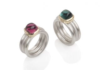 Tourmaline cushion shaped stones, set in 18ct gold on frosted silver rings.