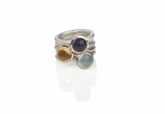 Three round cabochon stones set in 18ct gold on silver bands from a selection. Iolite, aquamarine and citrine.