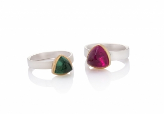 Trillion shaped tourmaline rings - blue-green and rubellite - set in 18ct yellow gold on polished silver  bands.