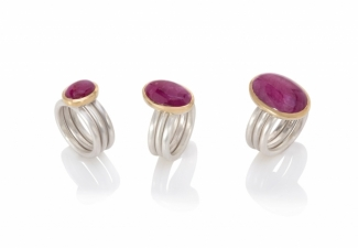 Three luscious untreated oval ruby cabochons each set in 18ct gold on three matte silver rings. From the left: a star ruby from Burma. a  Mozambique ruby and  a large Burmese ruby
