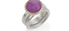 A natural, untreated Burmese ruby set in 18ct gold on frosted silver rings.