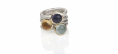 Three round cabochon stones from a selection. Iolite, aquamarine and citrine.