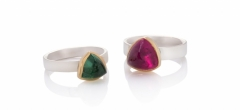 Trillion shaped tourmaline rings - blue-green and rubellite - set in 18ct yellow gold on polished bands.