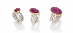 Three luscious ruby cabochons each set in 18ct gold on three matte silver rings. Left and right: a star ruby from Burma. Centre: from Mozambique.