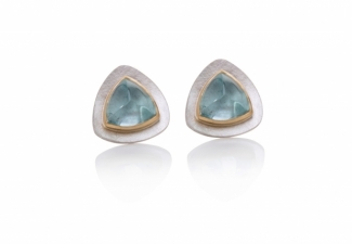 Trillion shaped aquamarine cabochon studs set in 18ct yellow gold on textured fine silver