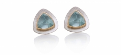 Trillion aquamarine cabochon studs set in 18ct yellow gold on textured fine silver