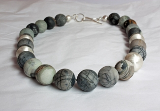 Necklace - 16mm Picasso jasper stones with silver features and clasp.