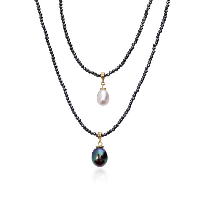 two hematite and pearl necklace, one with a white pearl and one with a peacock pearl pendant
